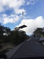 crane to remove solar hot water system heater from roof